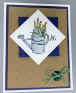 Encouragement, Watering Can on Woven Mat